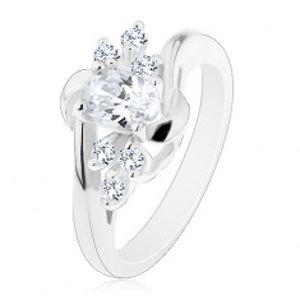 Lesklý prsten se zahnutými rameny, čirý ovál, blýskavé čiré zirkonky, obloučky AC17.27