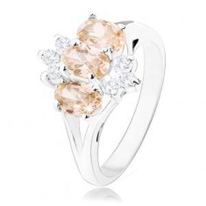Lesklý prsten ve stříbrném odstínu, oranžové zirkonové ovály, čiré zirkonky R34.27