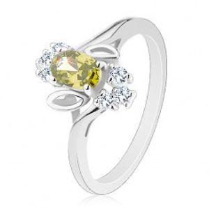 Prsten ve stříbrném odstínu, světle zelený broušený ovál, lístečky, čiré zirkony R30.16